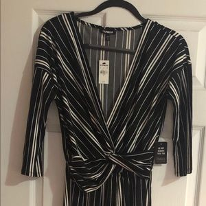 Black and white striped Express jumpsuit.